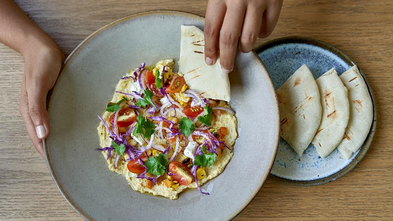 Overhead shot of healthy organic plant-based international cuisine for vegans and vegetarians