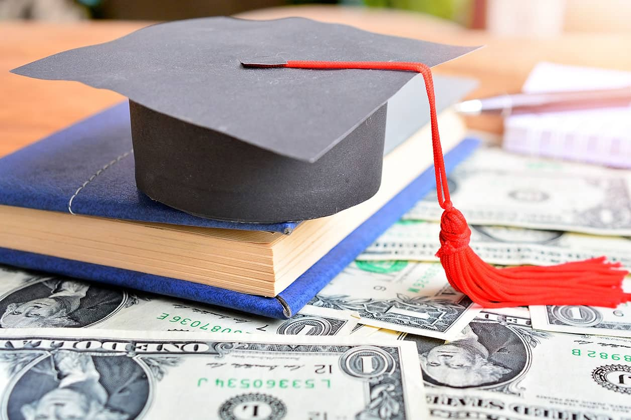 Hat graduation model on notebook for concept education and scholarships