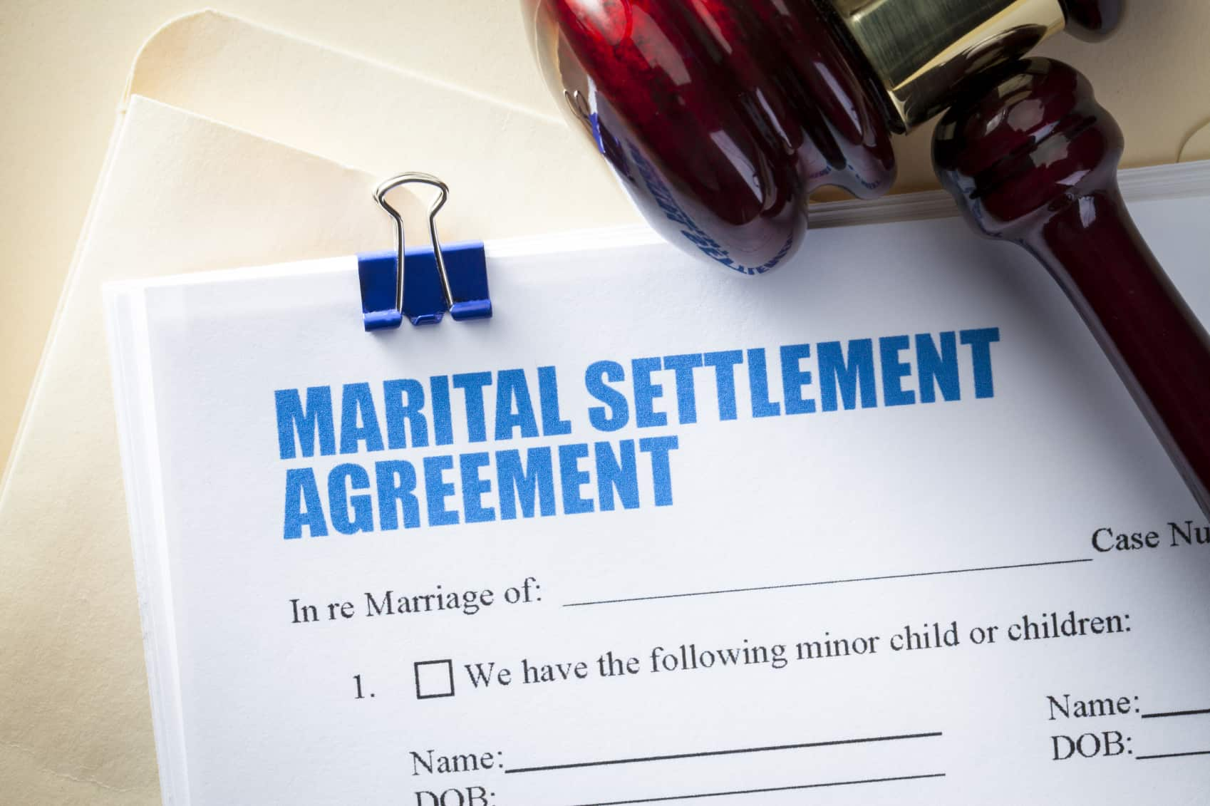 divorce and debt; divorce papers and gavel