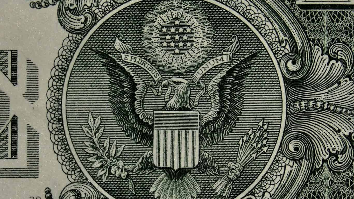 A photo of the eagle and shield symbol on the reverse of a one-dollar bill