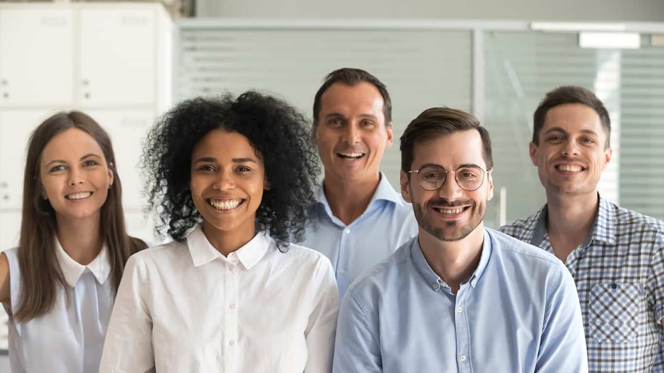 Smiling diverse office workers group, happy multiracial professional members employees looking at camera