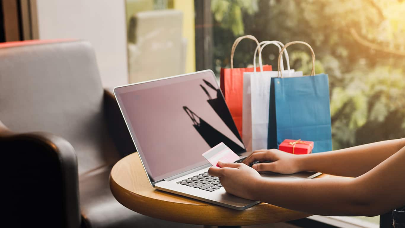 Women using laptop for shopping online and earn points to website.