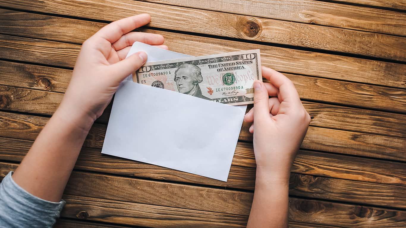 Use the cash envelope system