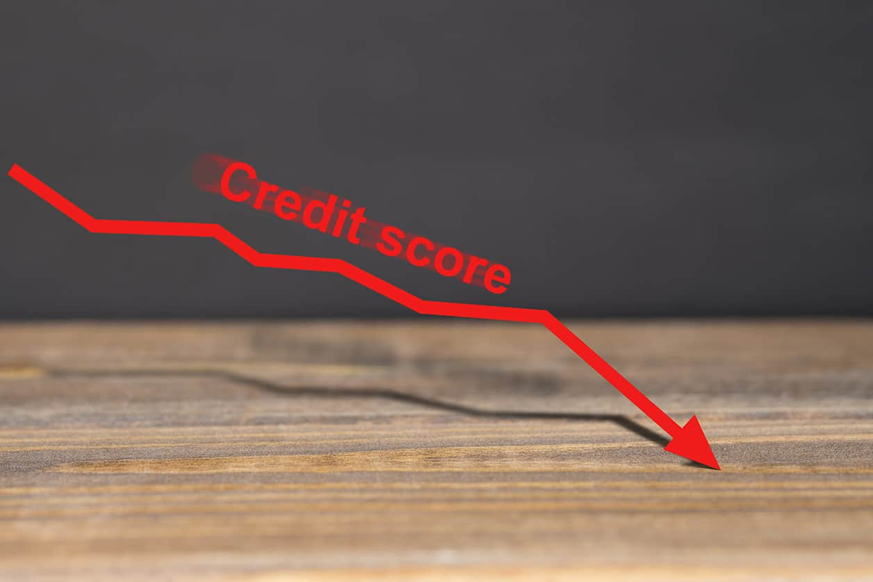 Red downward trend graph shows poor credit score