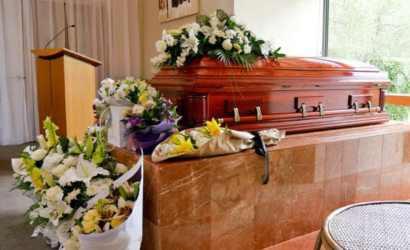 funeral costs; casket and flowers at a memorial service