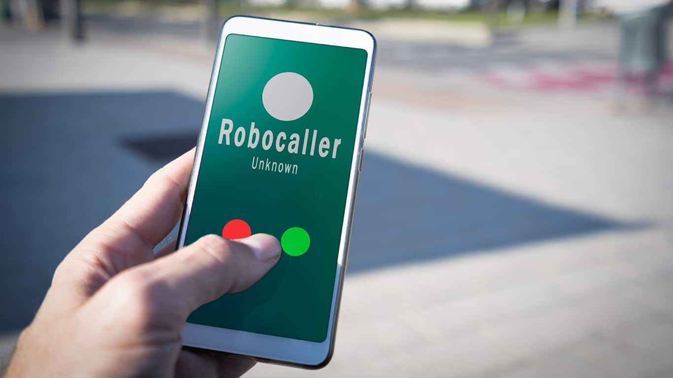 Smartphone showing on screen an illegal robocall.