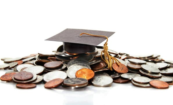 student loan interest rates; graduation cap on a pile of money ( student debt )