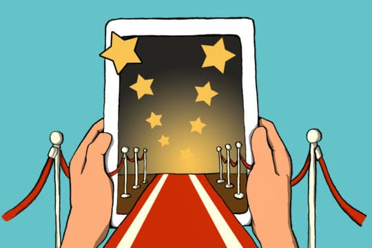red carpet and velvet ropes leading to a tablet (illustrated)