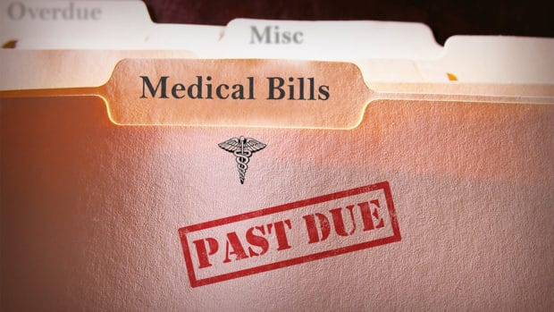 medical debt consolidation; file folders with past due medical bills