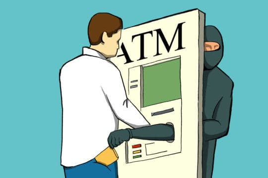 person at an ATM with a thief picking their pocket through the ATM (illustrated)