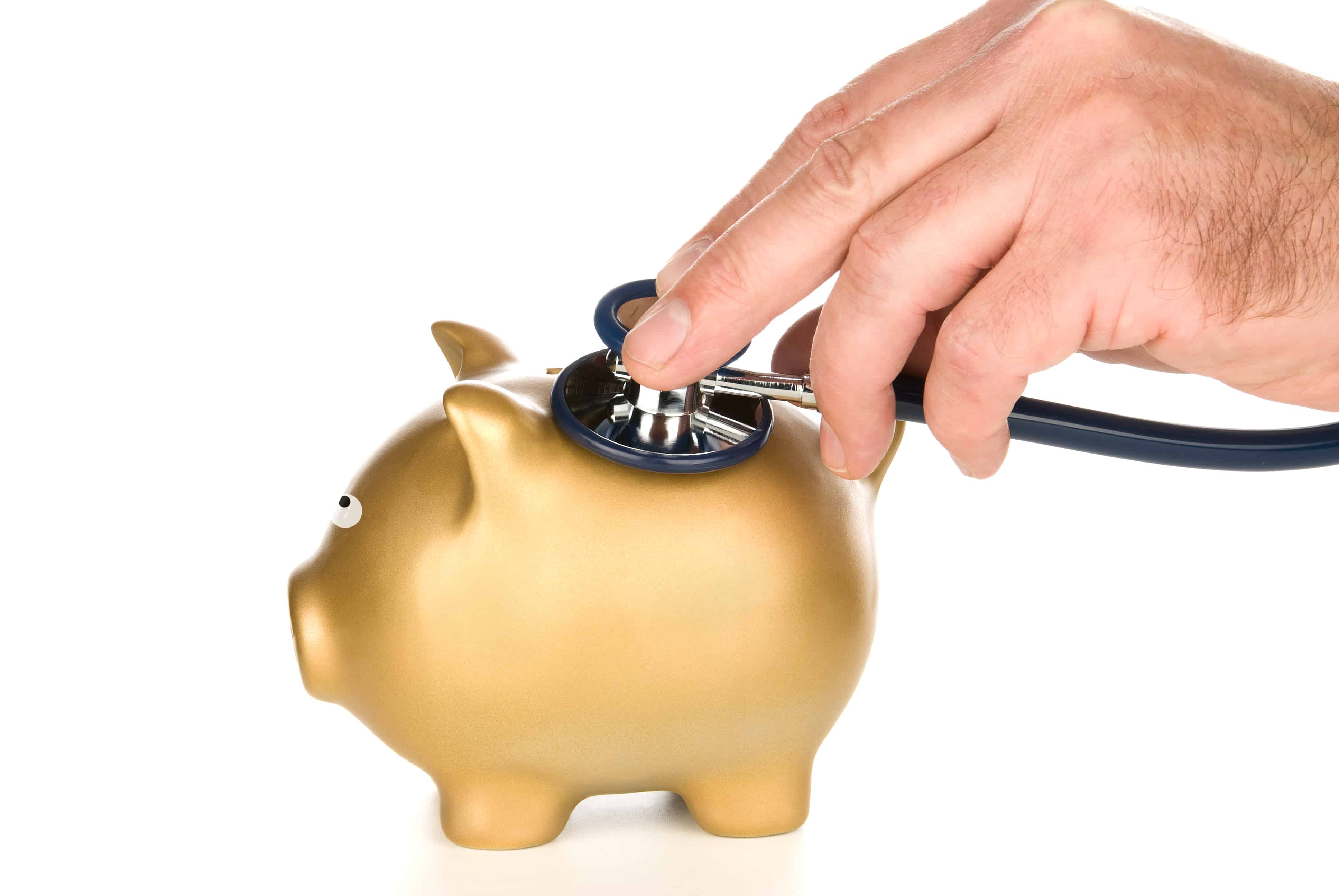 medical debt consolidation; piggy bank with stethoscope