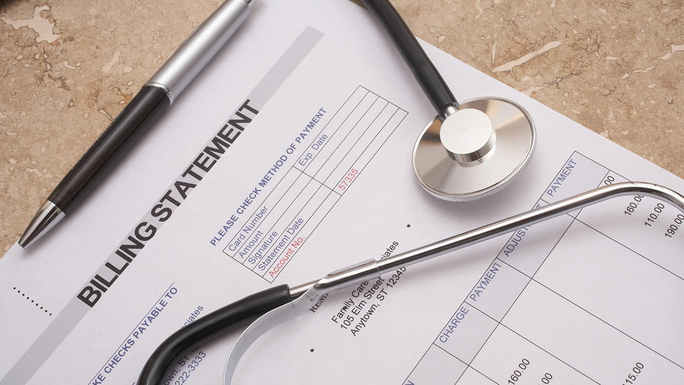 medical debt; billing statement with stethoscope