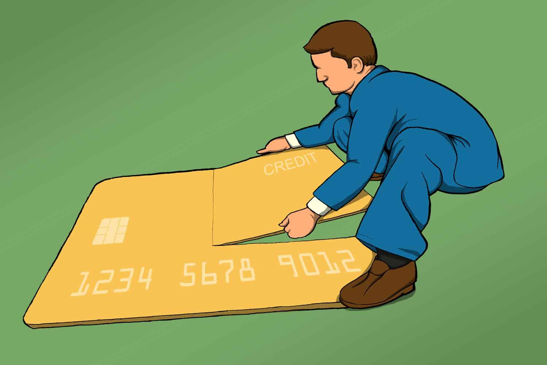 Man taking apart a large credit card puzzle (illustration)