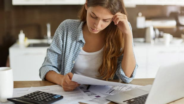 6 Roadblocks to Paying Off Debt and How to Overcome Them
