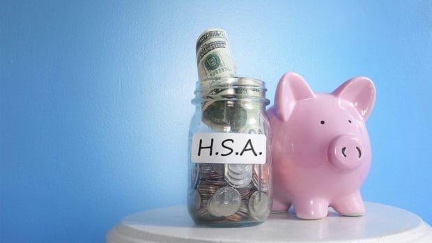 Health Savings Account ( HSA ) coin jar with piggy bank