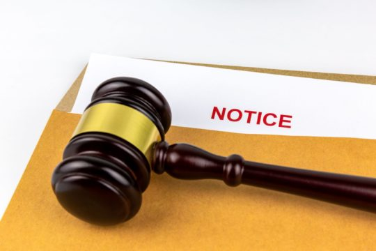 when do i need a debt collection attorney; gavel on top of court summons