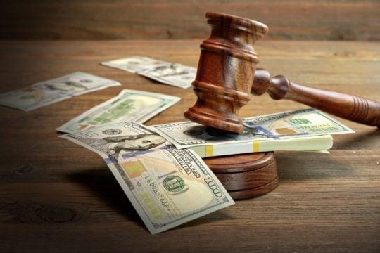 choosing a bankruptcy attorney; judge's gavel resting on dollar bill