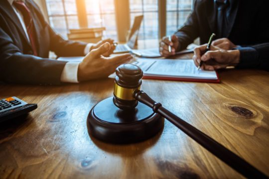 choosing a bankruptcy attorney; bankruptcy lawyer talking with a client