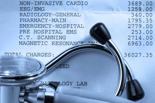 medical debt settlement; stethoscope on top of paper medical bill