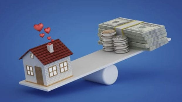 home equity line of credit; house balancing with money on a plank
