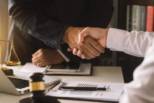 bankruptcy discharge and nondischargeable debt; bankruptcy lawyer shaking client's hand
