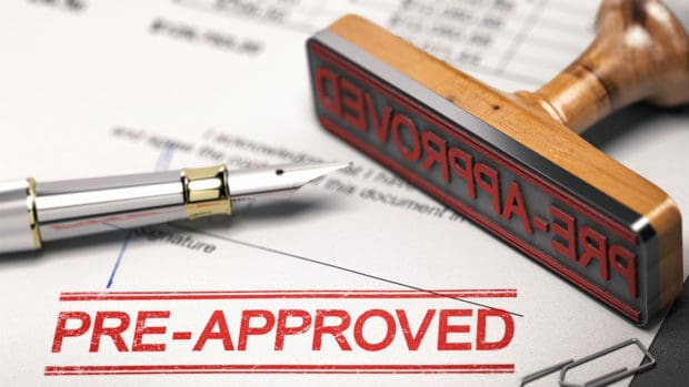 Printed document with rubber stamp and the word pre-approved