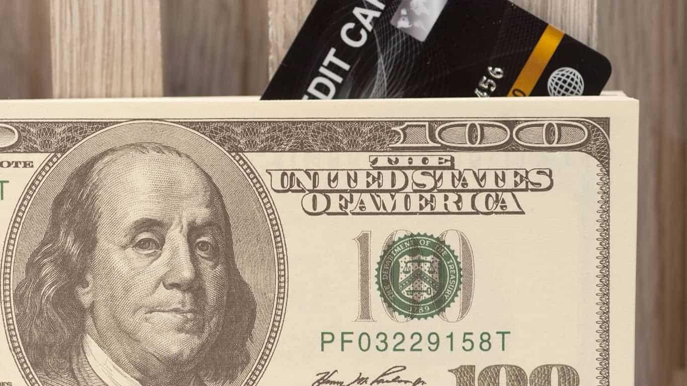 black credit card and american dollar