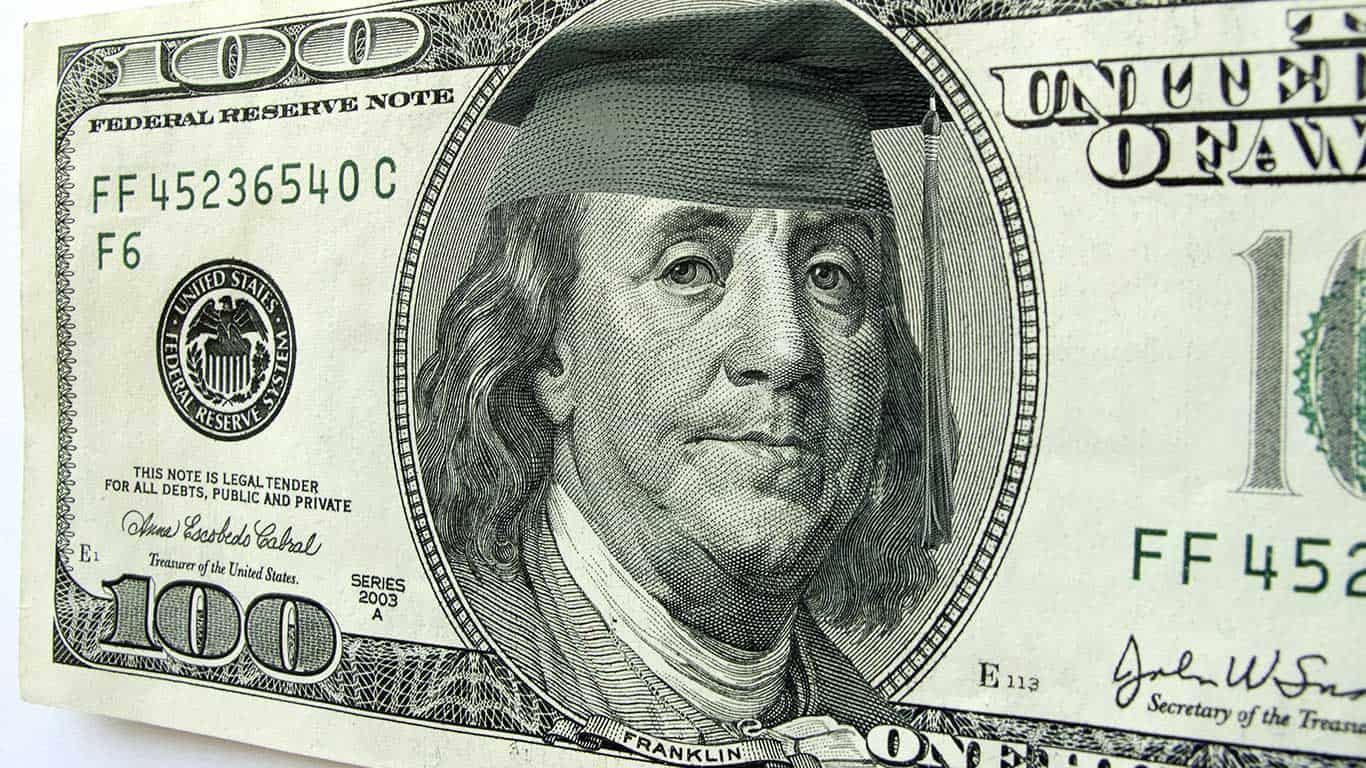Ben Franklin wears a cap and tassel