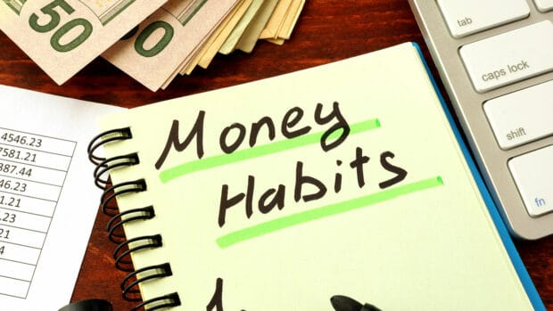 Notepad with word Money Habits. Saving and planning concept