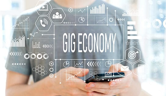 A gig economy graphic showing a woman managing business on her phone