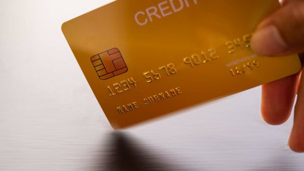 Selective focus Hand holding mock up golden credit card