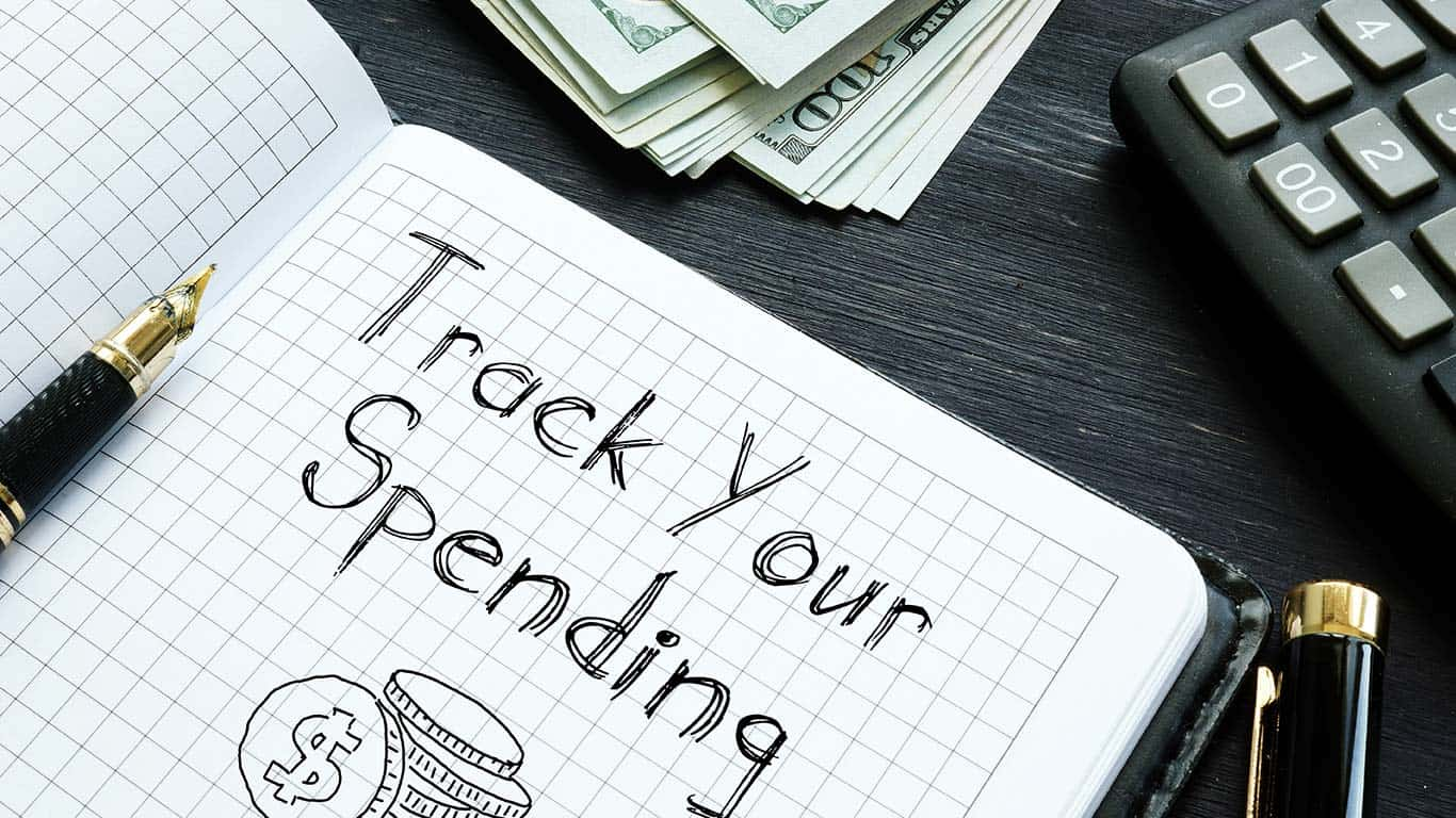 Track Your Spending is shown on the conceptual business photo